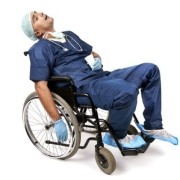 An exhausted physician sleeping in a wheelchair