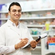 Cheerful pharmacist in retail store