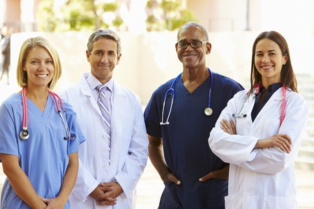 Physician, nurses, and a therapist
