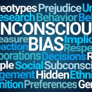 With a baseline norm of denial, how can institutions deal with unconscious bias?