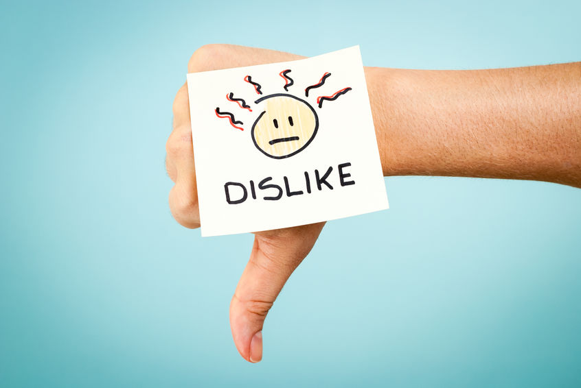 Image of a hand with a dislike emoji sticker making the thumbs down sign