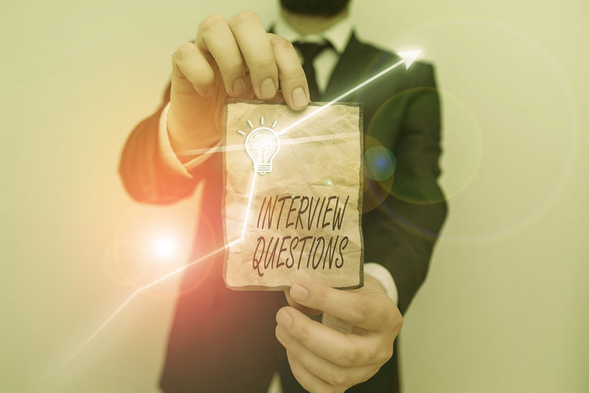 A healthcare human resources professionals holds a list of handwritten interview questions.