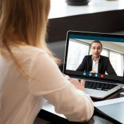 A female physician recruiter is conducting a virtual interview with a physician job candidate.