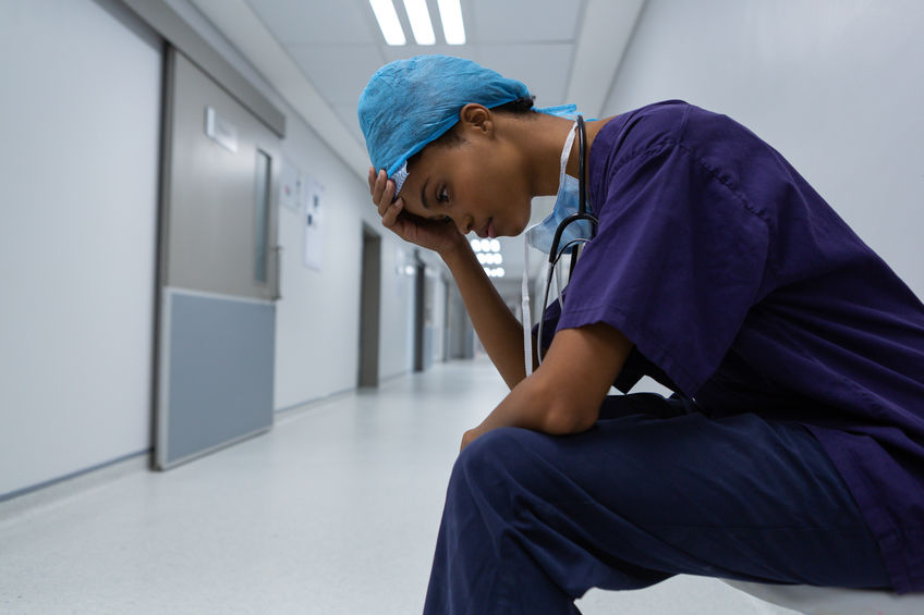 A picture of a nurse or physician suffering from anxiety in a hospital