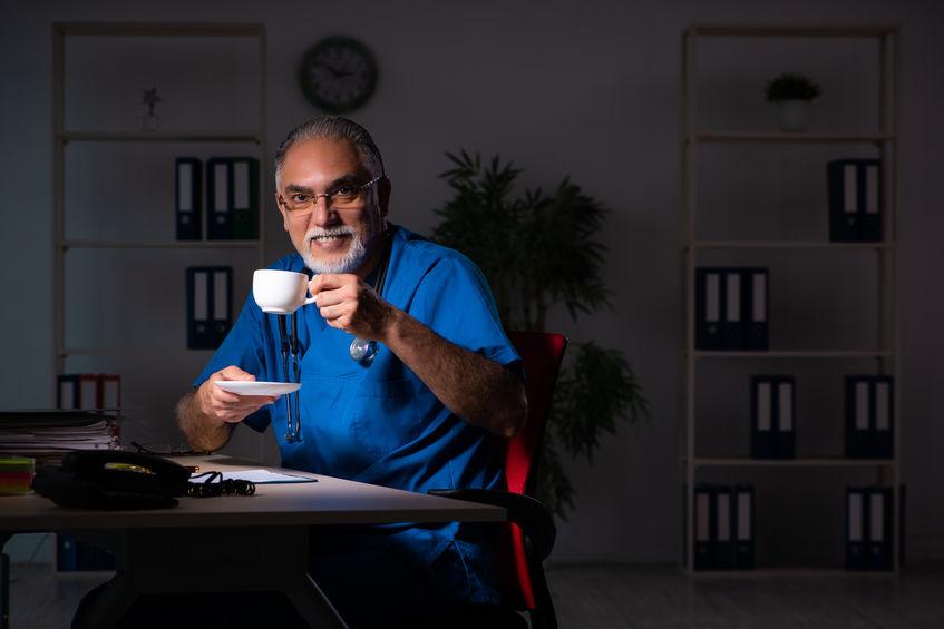 A night shift physician enjoying a coffee break