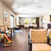 An image of a nearly empty waiting room illustrates the financial impact of covid-19 on healthcare providers.