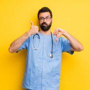 A physician evaluating work culture with thumbs up and thumbs down