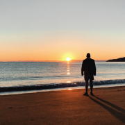 Man overlooking sunset on the ocean