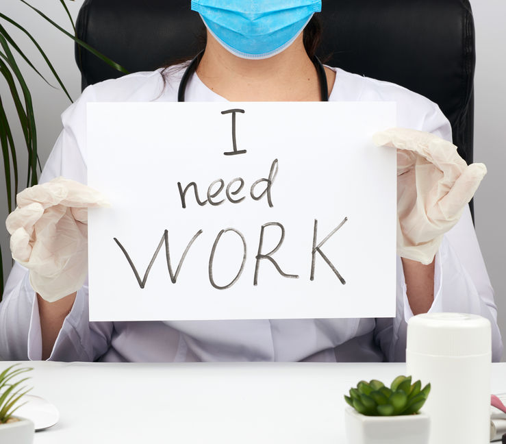 woman doctor in a white coat, sterile medical gloves holds a poster