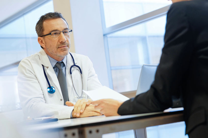 a doctor conducting an interview with a potential candidate