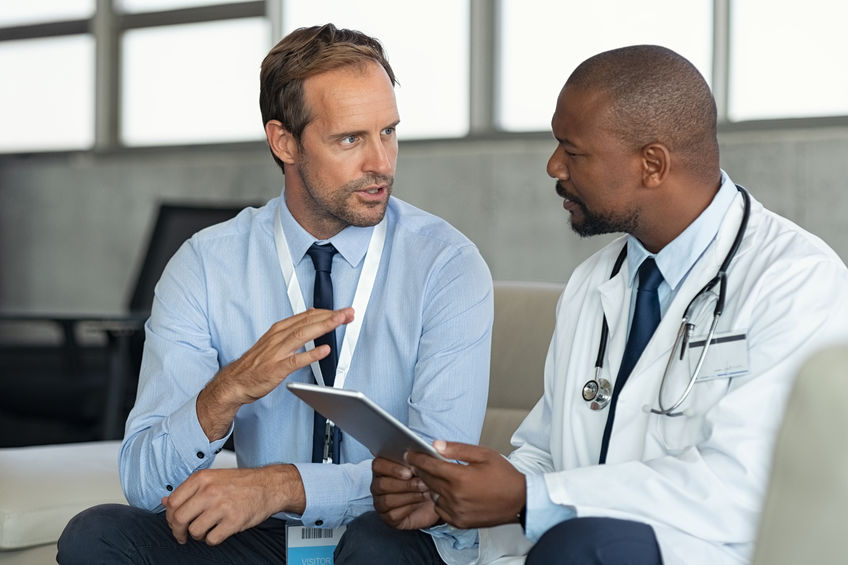 Consulting doctors speaking to each other