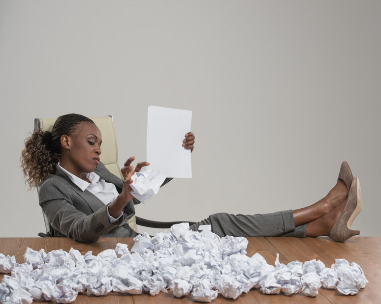 a woman crumpling papers