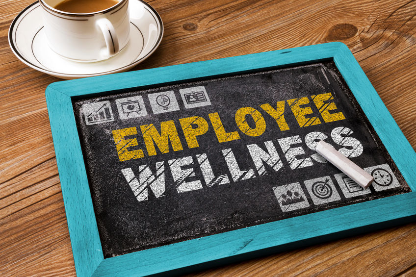 A chalkboard displays an employee wellness concept